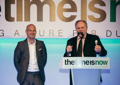 TV presenter Clive Anderson chairs the auction, which included a chance to play football with Freddie Ljungberg